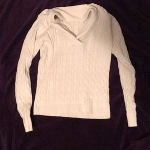 Cream colored cable knit pullover sweater
